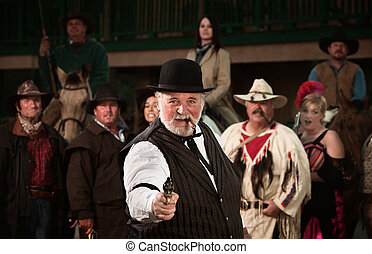 Gunshooter with gang in old American west theme