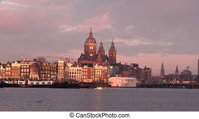 old Amsterdam city centre early in morning - morning in...
