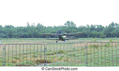 Old An-2 biplane moves along the runway