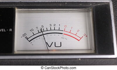 Old analog indicator. Arrow indicator of recording and playback signal. Levels meter.