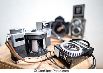 old analogue photographic cameras on the white background