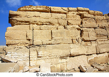 old ancient wall of sandstone