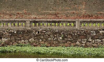 Old and ancient fence of the citadel in the city of the Hue, Imperial City. Vietnam.