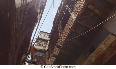 Old and crumbly apartment blocks - A hand held, low angle,...
