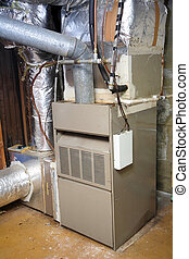 Old and dirty gas furnace - An old gas furnace in a dirty...