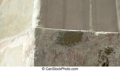 Old and dirty wall. Shabby wall texture. Remnants of bygone...