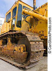 old and heavy bulldozer scraper, particular of track