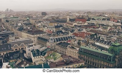 Old and modern buildings' roofs in Vienna on a cloudy day,...