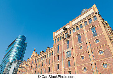 old and new building - restored factory building in front of...