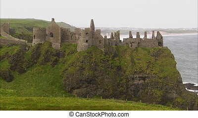 Old and ruined castle in Ireland - An extreme long shot of...