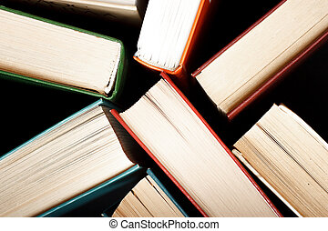Old and used hardback books or text books seen from above