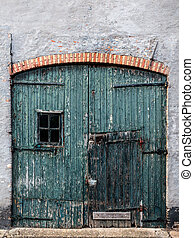 Old and weathered garage door in The Netherlands