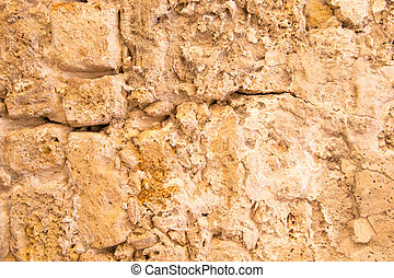 Old and weathered stone wall background,