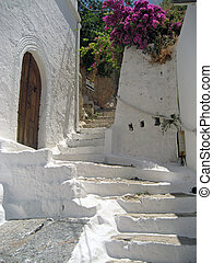 Old and worn whitewashed steps in a Greek town