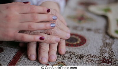 Old and young hands. Clous-up