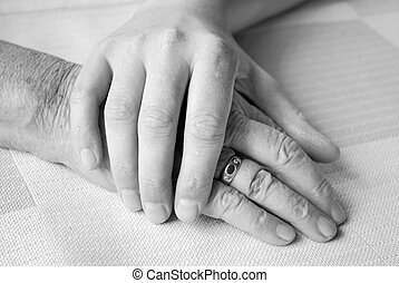 old and young - caring hand of a nurse and a senior patient