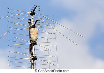 old antenna on a background of blue sky