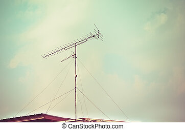 Old antenna with blue sky background - Vintage look filter,...