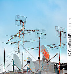 old antennas - old tv antennas on a building roof
