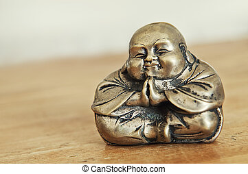 Old antique Budda in Thai style made from bronze, toned...