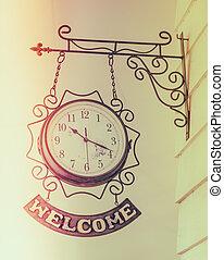 Old antique clock  ( Filtered image processed vintage effect. ) .