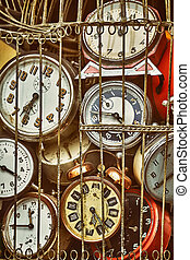 Old antique clocks in iron cage collection