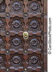 Old antique door and door handle, close up