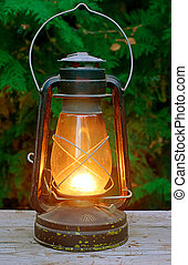old antique oil lantern on wooden table