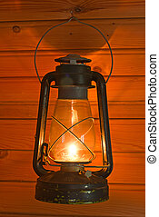 old antique oil lantern on woode wall