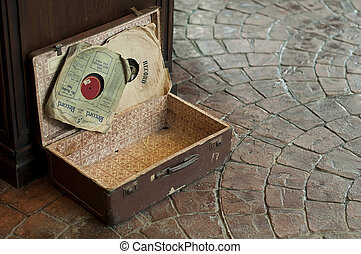 Old Antique suitcase with gramophone discs