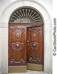 Old antique wooden door half-opened