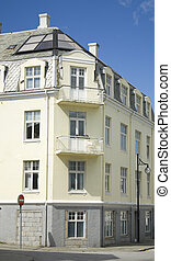 Old apartment building with modern roof window