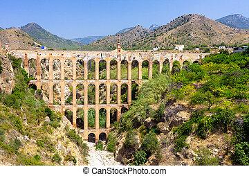Old aqueduct in Nerja, Spain - Old aqueduct in Nerja, Costa...