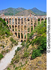 Old aqueduct in Nerja, Spain - Old aqueduct in Nerja, Costa...
