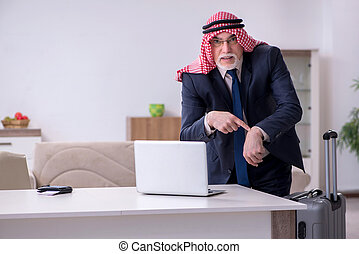 Old arab businessman preparing for business trip