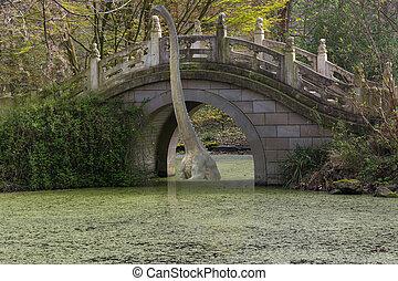 Old arch bridge on the lake