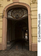 Old arched entrance with stained glass window