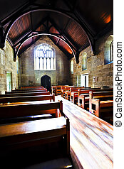 Old architecture church with wooden floor and benches