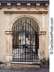 old architecture of the city with metal gates