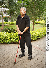 Old Asian man with walking stick - Old Indian Asian man...