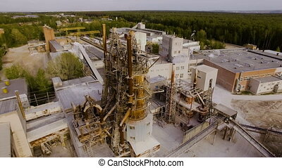 Old asphalt and concrete plant, with large metal structures. Aerial view