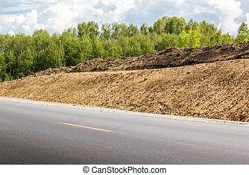 Old asphalt road with dividing line