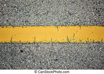 old asphalt texture with yellow line