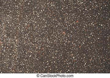Old asphalt with stones background