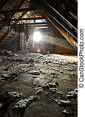 Sun rays lighting the garbage in an old attic
