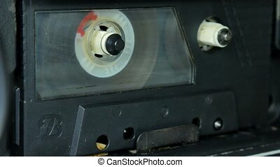 Old Audio cassette reel playing.