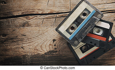 Old audio tape compact cassettes on wooden background. top ...