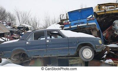 old auto scrap metal dump abandoned landfill outdoors...