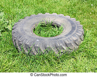 old automobile wheels on a green grass