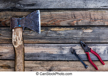 Old ax and other tools lying on the boards